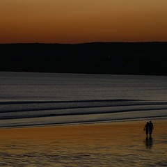 a warm glow (limerickdoyle) Tags: sunset beach onthebeach westclare atlantic munster countyclare redstrand irishlandscape lehinch oranage reflectingsunset canon400d atlanticsunset irishscene colourartaward nearthecliffsofmoher colouratsunset
