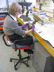 Conservator cleaning a candlestick from a choirscreen from 's-Hertogenbosch.