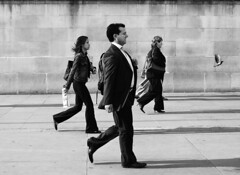The Rat Race  (ro_nya) Tags: uk england bw london walking cool suits unitedkingdom trafalgarsquare explore rushhour arewethereyet coordination 123bw ronya londonstreetphotography sauvette ronyagalka only35moreyearsofthis ronyagalkacom