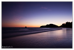 Sunseting (Max Kehrli) Tags: ocean blue sunset orange sun color colour beach canon dark evening bay coast sand colorful december wave atlantic bermuda horseshoe colourful 1022 6138 40d