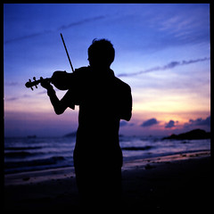 Sunset violinist (Lefty Jor) Tags: sunset sea sky hk reflection 120 6x6 film beach water clouds t hongkong golden sand dof kodak hasselblad violin violinist planar 500cm carlzeiss proxar 80mmf28 ektacolorpro160