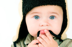 Dominic (Sergiu Bacioiu) Tags: baby white cute hat studio little sweet expression background small you