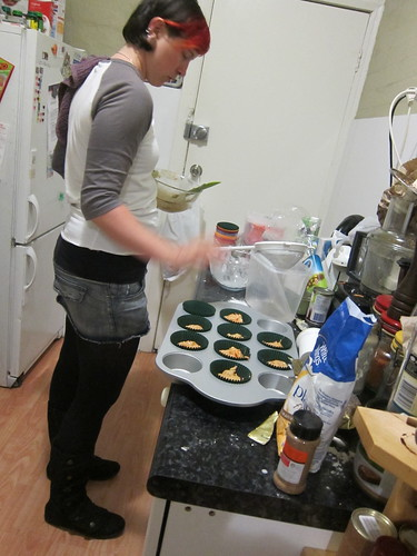 Kelsey making carrot cupcakes