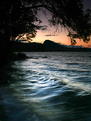 Kickininee Park (storm light) Tags: sunset lake canada tree beach water silhouette swimming cool waves bc dusk okanagan lakeshore wading okanaganlake kickinineeprovincialpark