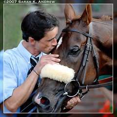 Stealing a kiss in the winners' circle (Rock and Racehorses) Tags: ny france french kiss belmont explore manowar racehorses anawesomeshot doctordino
