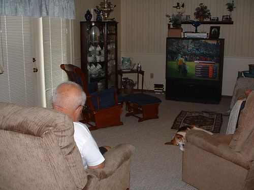 "Dad ""watching"" golf."