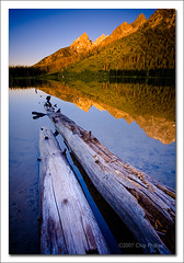Teton Sunrise, String Lake#1 (Chip Phillips) Tags: blue sky lake mountains reflection water vertical sunrise reflections landscape photography bravo warm phillips logs grand calm jackson chip string canon5d wyoming teton tetons alpenglow canon1740 magicdonkey alemdagqualityonlyclub