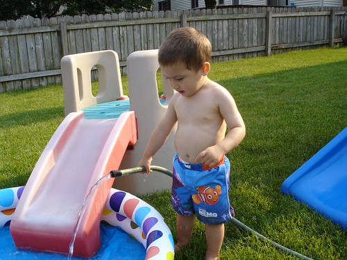 Mason filling up the pool