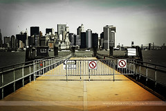 No Trespassing, Liberty Island, New York (Seven Seconds Before Sunrise) Tags: nyc newyorkcity newyork building water sign skyline architecture fence 50mm unitedstates libertyisland notrespassing