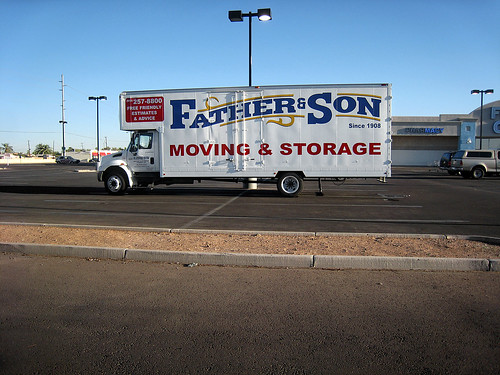 father and son moving van
