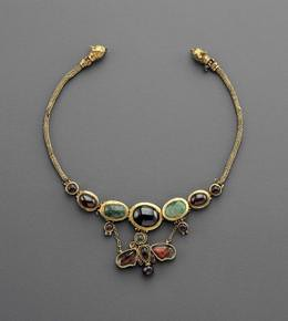 A Hellenistic Butterfly Necklace Composed of Gold, Emerald, and Garnet