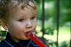 The Tastes and Colors of Summer (dawnzy58) Tags: boy red evan green 50mm toddler grandson icepop frozentreat 17monthsold coffeeshopaction