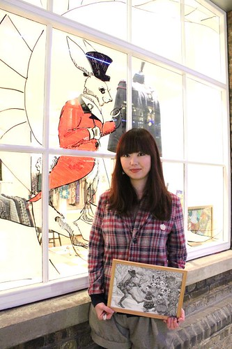 Chikako with her window art with QOS lapel Cardigan