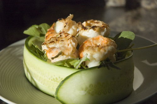 grilled rosemary shrimp with arugula in a cucumber bowl