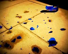Broken indigo (Luke Robinson) Tags: uk blue london broken glass pavement indigo sidewalk picnik 2007