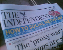 "Newspaper with headlines ""How to Social Network"""