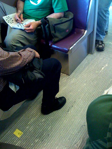 A bag taking up a seat on TriMet