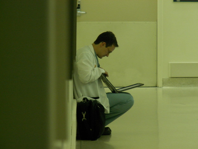 Doctor Reading Articles