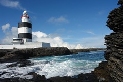 Hook lighthouse (CharlesFred) Tags: ocean ireland sea cloud sun coast waves eire atlantic coastal hook splash wexford atlanticocean emeraldisle roack countywexford oirland irishcoast oceanswell hooklighthouse