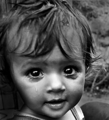 Blessed (Divs Sejpal) Tags: life portrait people blackandwhite bw india cute smile closeup reflections hair kid eyes asia tears child expression expressions innocence cry tender gujarat ahmedabad divs divyesh intrestingness flickrexplore explored sejpal