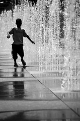 The Art Of Play (peterkelly) Tags: boy bw playing toronto ontario canada film wet water fountain downtown child running canadian spray northamerica dundassquare