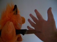 Small victory (helixdmonster) Tags: orange monster hands puppets cpm helix knives stabbing handpuppets creepyhands smallvictory monsterhandpuppets helixdmonster msh0907 msh090717