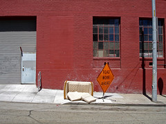 (michale) Tags: sanfrancisco california street door blue shadow red orange wall pavement garage sidewalk sofa loveseat garagedoor roadworkahead