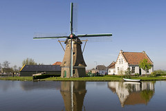Windmill and old houses in Schipluiden - by waterwin
