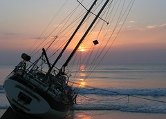 Grounded At Sunrise (minds-eye) Tags: ocean sunset red sea sun beach water sunrise boat waves florida ponte craig sail mast stranded schooner seas oneal marooned vedra