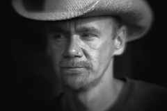 Marlboro Man? (The Legendary Cobo) Tags: portrait bw blur hat dark cowboy dramaticportraits wronglens