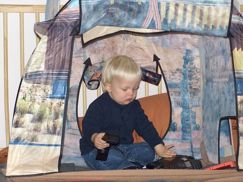Nicholas playing with our old phone in his playhouse