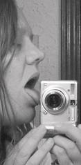 day 216 of 365 = camera love (libraryann) Tags: camera bw tongue austin lick 2007 day216 365days andilickedit flickrgrouproulette clemsaknob we3clem thetrialrulescauseilovebologna clemrocksthekasbah