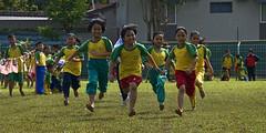 Run ....... Don't Stop (framptoP - E.V.I.L. Photographer) Tags: sport children flickr sony running sarawak a350 batukawa iamflickr carnivalschoolasian malaysiankuching