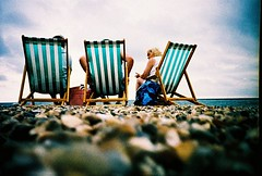 The great British seaside (Jonee..) Tags: sea sky people cold film beach stone 35mm lomo lca deckchair crossprocess shingle 100v10f pebble selected folio lowdown littlehampton agfaprecisa100 forsite interestingness132 i500 virb 957ten