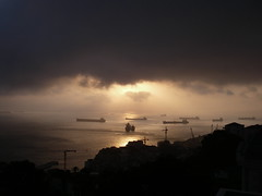 Hole in the cloud (Philip Vasquez) Tags: bay spain ships sunsets gibraltar tankers levante rosia