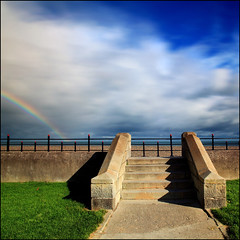 At The Seaside - Ireland (angus clyne) Tags: life new autumn ireland light shadow sea summer dublin irish cloud holiday art fall grass rain stone composition canon dark lens seaside rainbow october long exposure wind time angus mark walk air steps lawn picture r