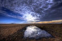 Desigual (Leandro MA) Tags: cielo nubes serrada charco sigma1020 canoneos40d leandroma