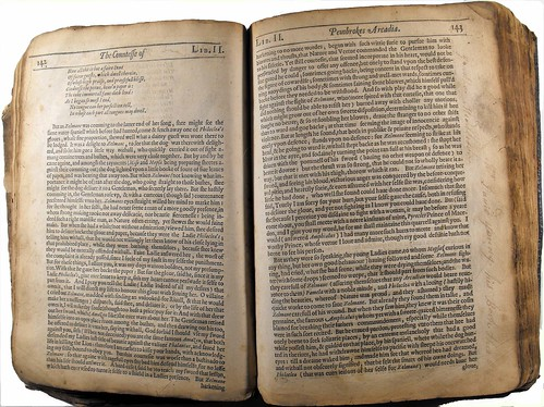 Double page opening of text with ownership inscription in right margin of page 143.