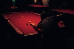 Pool Hall (clarkmackey) Tags: red film pool backlight bar dark moody fuji slide backlit bachelorparty redlight olympusxa 2007 barleys ashevillenc 400x impliedmotion charlielooney submitlightclub googleavl isupportgooglefiberasheville