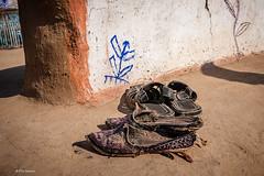 Rajasthani farmer's street shoes outside his hut in a Bishnoi village in Rajasthan, India (Phil Marion) Tags: rajastan india travel philmarion philippemarion masala henna tamil hindu puja punjabi hindi sikh incredibleindia ganges ghat explored explore