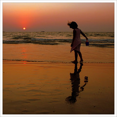 Shells collecting (JannaPham) Tags: world sunset shells india reflection girl walking gold one this evening perception goa like lot explore excellent karma emotions collecting holidaybeach 500x500 bsquare explorefrontpage capturei jannapham