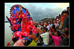 Bishorjon (ronysyful) Tags: blue red sky people music motion color art water festival canon river fun photography concert wide lifestyle gathering excellent ritual hindu puja kushtia