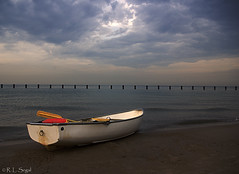 Rowboat Waits Out the Storm (rjseg1) Tags: lake chicago storm beach clouds boat dusk lakemichigan rowboat segal supershot outstandingshots pentaxk10d illinoisthunderstorms