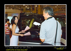 Isuzu Model(DGMate-instructing-the-model-with-his-charm)- (Francis Jeff Manalo) Tags: model worldtradecenter philippines isuzu campi dgm francisjeffmanalo dinomateo 1stinternationalmotorshow
