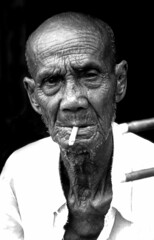 A Cambodian Musician (El-Branden Brazil) Tags: cambodia khmer buddhism angkorwat temples phnompenh siemreap angkor bayon theface mailciler