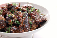 Sesame Drumsticks with Balsamic Honey Glaze (jpellgen) Tags: summer food house chicken home cooking minnesota table nikon sesame august bowl seeds 1855mm balsamic nikkor parsley 2008 foodnetwork giadadelaurentiis d40 everydayitalian