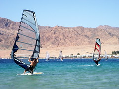 dahab sails (kexi) Tags: blue sea mountains water nikon holidays december wind turquoise dahab redsea sails egypt windy racing coolpix translucent watersports 2008 coolest windsurfers winsurfing instantfave thebestofday