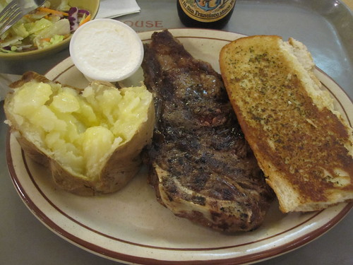 Salad, bread (uneaten), steak, baked potato with butter and sour cream at Tad's Steak House - $19.80 including one beer