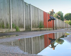 Day 179 / 365 - The red panels (vvt) Tags: selfportrait reflection home me wet water rain puddle mirror jump alley another behind vvt 365days wheresbloodysummer