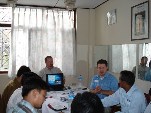 Patrick leading the Nepalese brothers through the CSC PowerPoint presentation